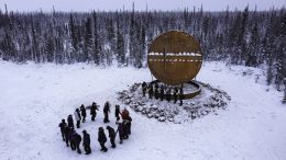 Residents of Fort Good Hope have a drum dance to celebrate the new Arctic Circle Drum monument on March 15. (photo courtesy of the Department of Industry, Tourism and Investment)